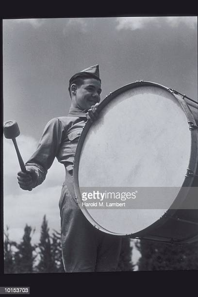 BOY SCOUT WITH LARGE DRUM AND MALLET, 1950