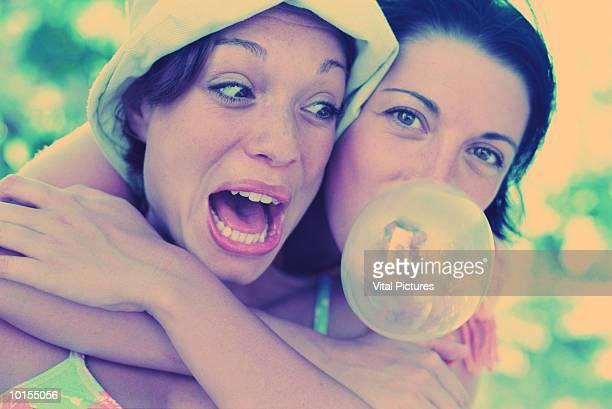 WOMEN BLOWING BUBBLE GUM, CHILDISH, 20S
