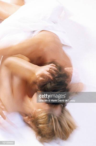 couple making love - couples making passionate love stock pictures, royalty-free photos & images