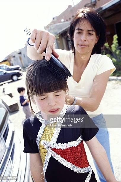 MOM BRUSHING DAUGHTERS HAIR