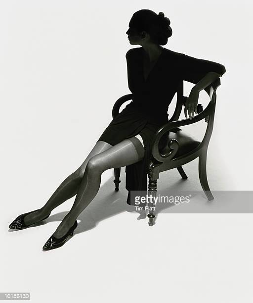SILHOUETTED WOMAN ON CHAIR