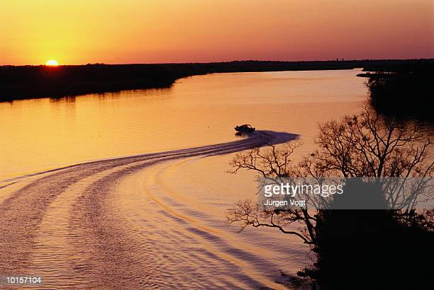 SUNSET AND BOAT ON BAYOU, PORT ARTHUR TEXAS