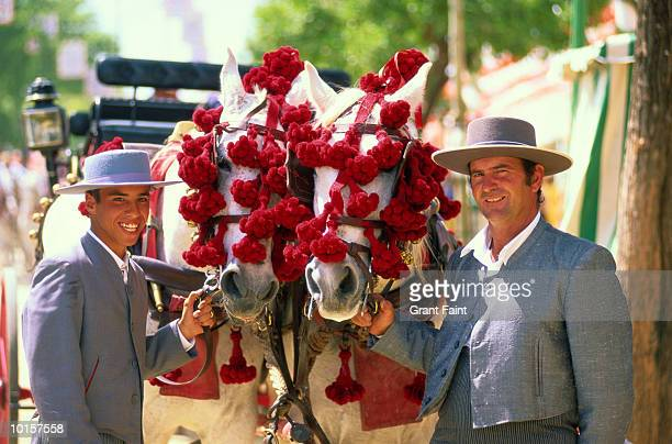 spain, seville fair, father and son - fete stock pictures, royalty-free photos & images