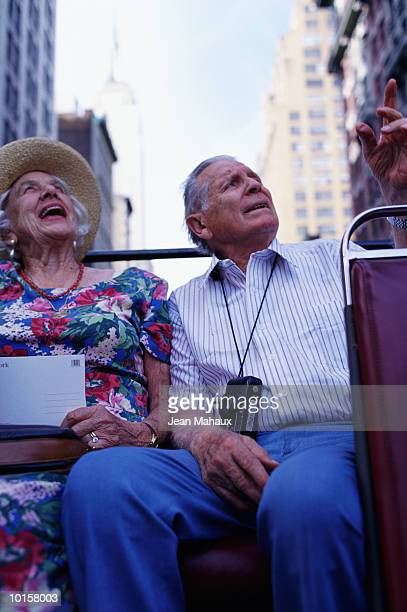 SENIOR TOURIST COUPLE TIMES SQUARE