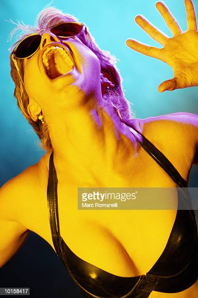 portrait of angry young woman - gel effect lighting stock photos and pictures