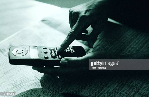 HAND DIALING PHONE NUMBER