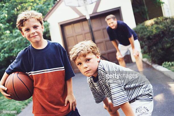 DAD AND TWIN BOYS ON DRIVEWAY, BASKETBALL