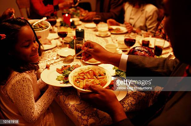 family holiday dinner, christmas - african american christmas images stock pictures, royalty-free photos & images