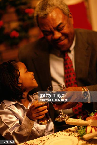 holiday dinner, grandpa, grandkid - african american christmas images stock pictures, royalty-free photos & images