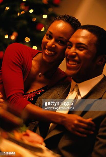 holiday dinner young couple - african american christmas images stock pictures, royalty-free photos & images