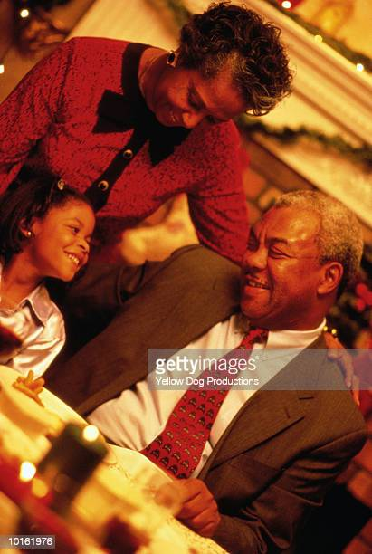 holiday dinner, grandparents, granddaughter - african american christmas images stock pictures, royalty-free photos & images