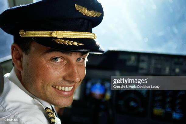PORTRAIT OF PILOT IN COCKPIT