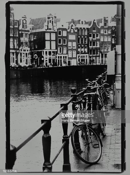 BICYCLES AT GRACHT, AMSTERDAM, NETHERLANDS