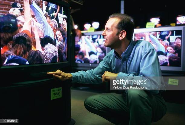 MAN SHOPPING FOR TELEVISION