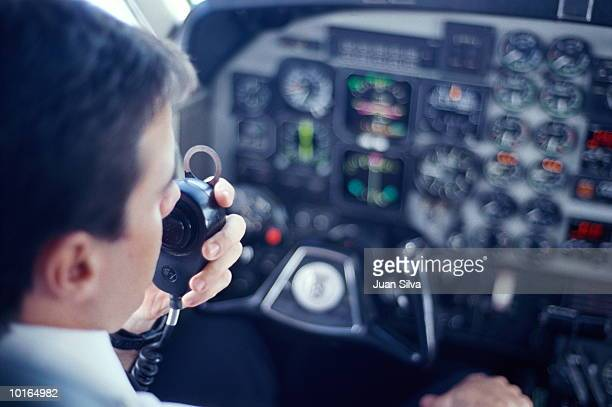 AIRPLANE PILOT TALKING ON RADIO
