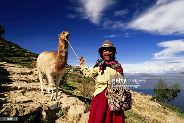 AYMARA INDIAN GIRL WITH LLAMA, BOLIVIA