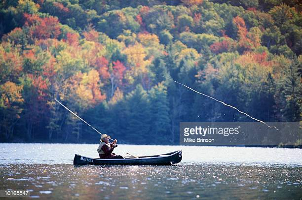 fly fisherman in canoe, vermont, usa - vermont stock pictures, royalty-free photos & images