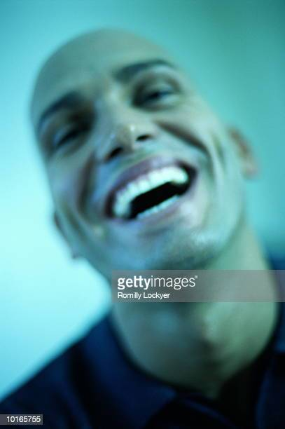young bald man laughing - cross processed stock pictures, royalty-free photos & images
