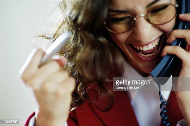 BUSINESSWOMAN WITH SUNGLASSES ON PHONE