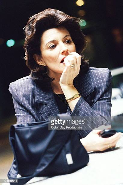 businesswoman, 50 years old, thinking - 50-59 years and women only fotografías e imágenes de stock