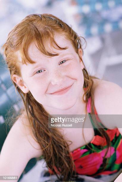 YOUNG GIRL WITH LONG RED HAIR, POOL PARTY