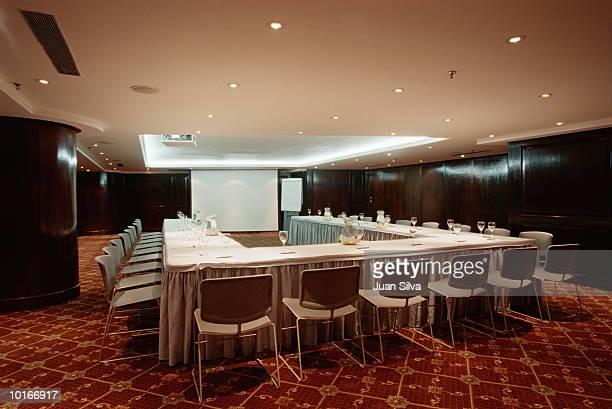HOTEL CONFERENCE ROOM WITH TABLES