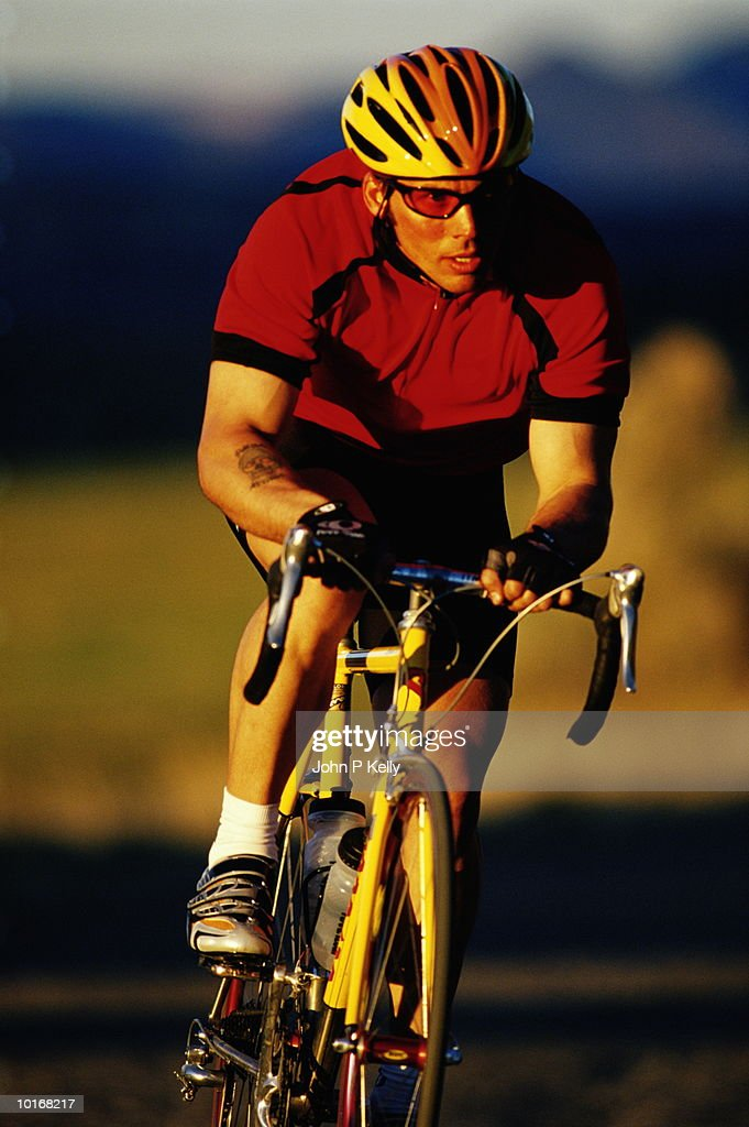 MAN ROAD CYCLING, WESTERN COLORADO : Stock Photo
