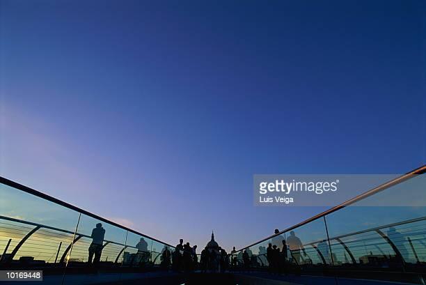 millennium bridge, st pauls, london, england - footbridge stock photos and pictures