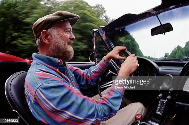 MATURE MAN DRIVING CORVETTE