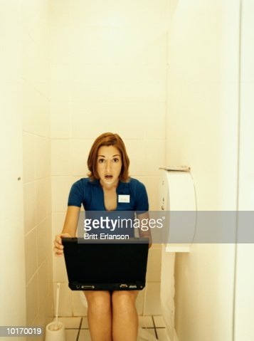 Woman With Laptop In Public Toilet Stock Photo Getty Images
