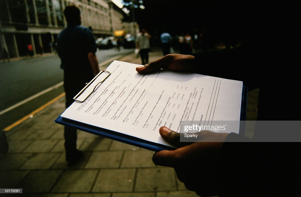 MARKET RESEARCHER ON THE STREET : Stock Photo