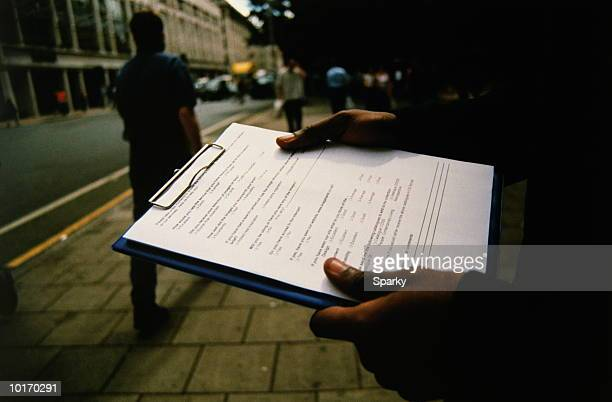 market researcher on the street - questionnaire stock pictures, royalty-free photos & images