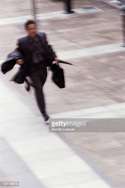 running businessman - generic location stock pictures, royalty-free photos & images