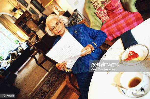NINETY YEAR OLD WOMAN READING LETTER