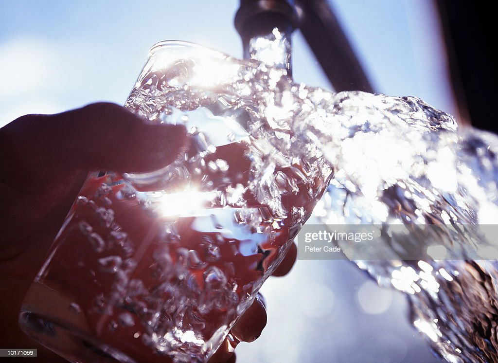 FILLING GLASS WITH WATER : Stock Photo