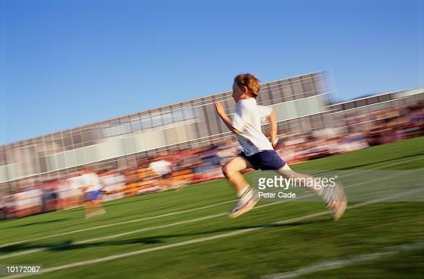 TEN YEAR OLD BOY RUNNING ON SCHOOL SPORTS DAY