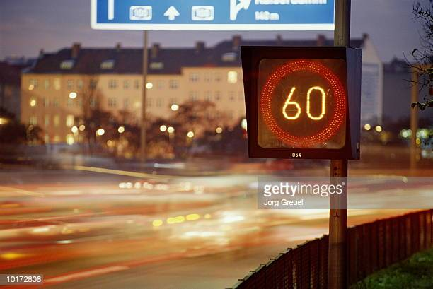 speed limit sign on road at night - number 60 stock photos and pictures