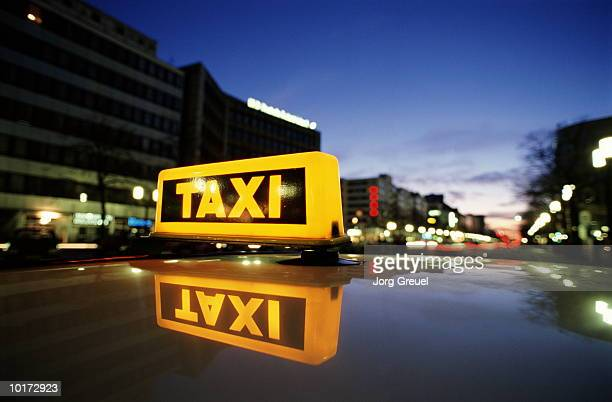 taxi sign, berlin, germany - taxi stock pictures, royalty-free photos & images