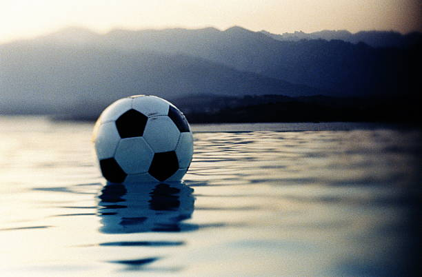 FOOTBALL FLOATING IN WATER