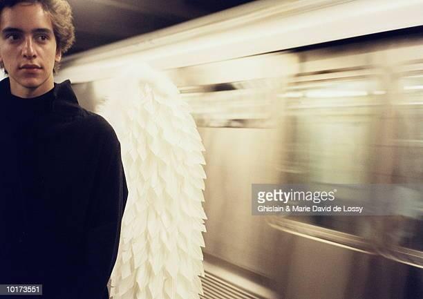 MAN WEARING ANGEL WINGS, CLOSE UP