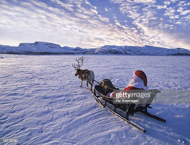 santa figure in sleigh, norway - sleigh stock photos and pictures