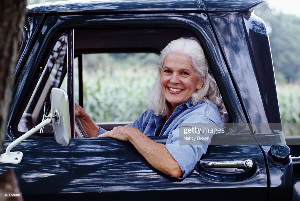 Mature Woman In Pickup Truck High-Res Stock Photo - Getty