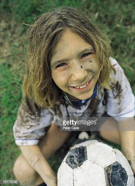 10 yr old girl with soccer ball - dirty little girls photos stock pictures, royalty-free photos & images