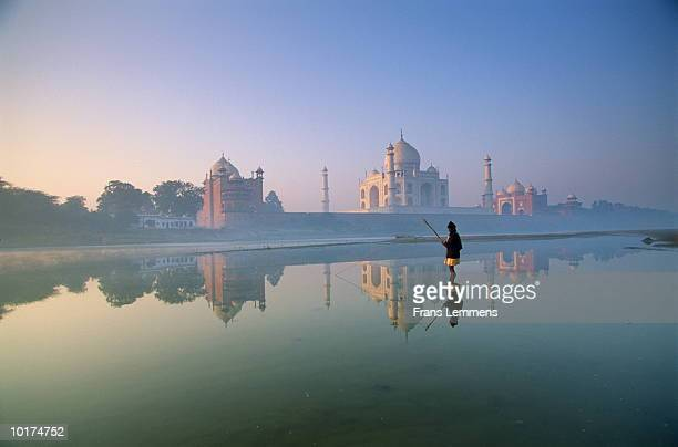 man fishing, with taj mahal in background - yamuna river stock pictures, royalty-free photos & images