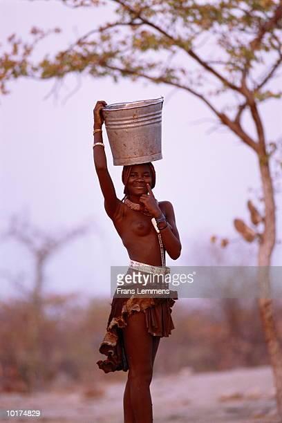 himba girl transporting water - himba bildbanksfoton och bilder