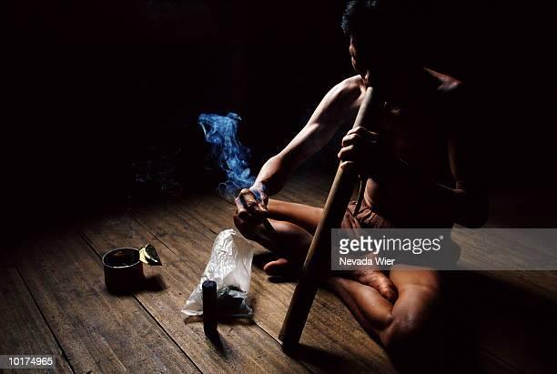 man smoking pipe, (land dyaks), malaysia - dayak stock photos and pictures