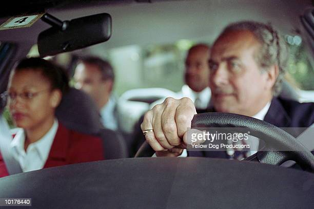 BUSINESS PEOPLE IN CAR