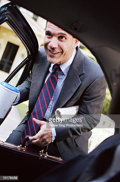 BUSINESS PEOPLE SMILING IN CAR