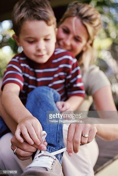 mom teaching son how to tie his shoelaces - shoelace stock pictures, royalty-free photos & images