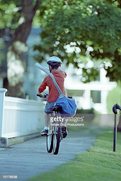 PAPERBOY DELIVERING NEWSPAPER ON BIKE